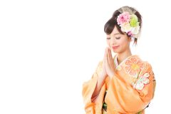 japanese woman wearing kimono on white background